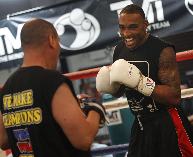Boxer J'Leon Love, right, spars with Rafael Ramos while working out for the media in preparation for his upcoming fight against Marco Antonio Periban at the Mayweather Boxing Club in Las Vegas on  ...