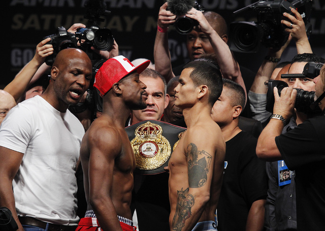 Boxers Floyd Mayweather Jr., left, and Marcos Maidana face off following their weigh-in at the MGM Grand Garden Arena in Las Vegas on Friday, May 2, 2014. (Jason Bean/Las Vegas Review-Journal)