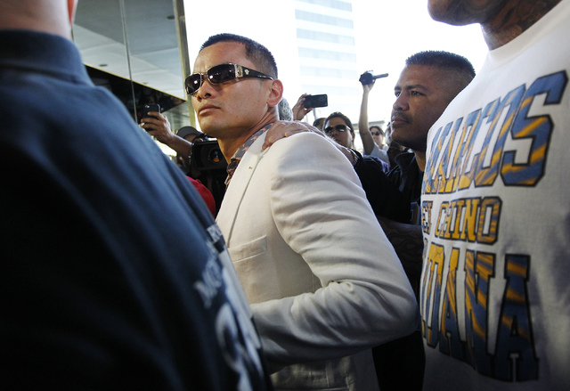 Boxer Marcos Maidana gets ushered inside while arriving at the MGM Grand prior to his fight against Floyd Mayweather Jr. in Las Vegas on Tuesday, April 29, 2014. (Jason Bean/Las Vegas Review-Journal)