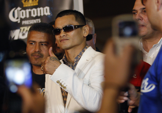 Boxer Marcos Maidana signals to his fans after arriving at the MGM Grand prior to his fight against Floyd Mayweather Jr. in Las Vegas on Tuesday, April 29, 2014. (Jason Bean/Las Vegas Review-Journal)