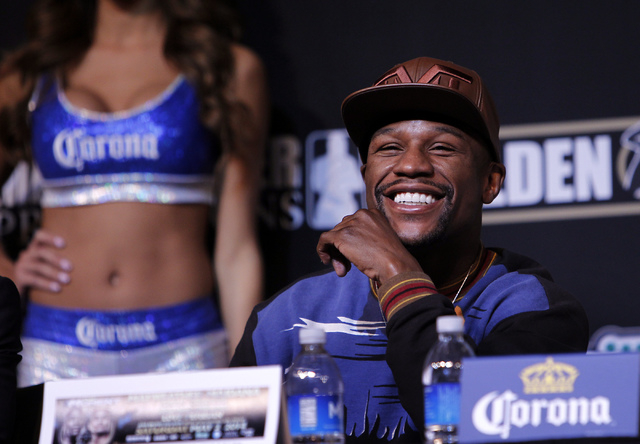 Boxer Floyd Mayweather Jr. laughs during a press conference prior to his fight against Marcos Maidana at the MGM Grand in Las Vegas on April 30, 2014. (Jason Bean/Las Vegas Review-Journal)