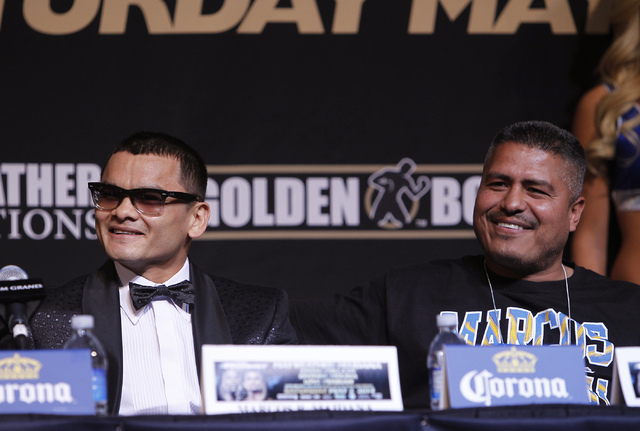 Boxer Marcos Maidana sits next to his trainer Robert Garcia during a press conference prior to his fight against Floyd Mayweather Jr. at the MGM Grand in Las Vegas on April 30, 2014. (Jason Bean/L ...