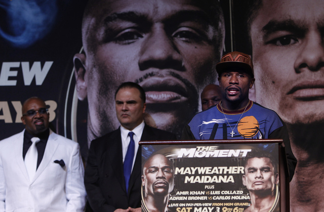 Boxer Floyd Mayweather Jr. talks to the media during a press conference prior to his fight against Marcos Maidana at the MGM Grand in Las Vegas on April 30, 2014. Seen in the background, from left ...