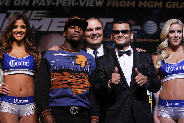 Boxers Floyd Mayweather Jr., left, and Marcos Maidana pose for the media during a press conference prior to their fight at the MGM Grand in Las Vegas on April 30, 2014. Seen in the background is G ...