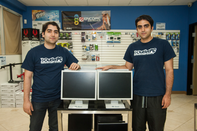 Outlet PC co-founding brothers Sherveen, left, and Kia Javadi pose inside their company headquarters in Henderson on May 15. (Martin S. Fuentes/Las Vegas Review-Journal)