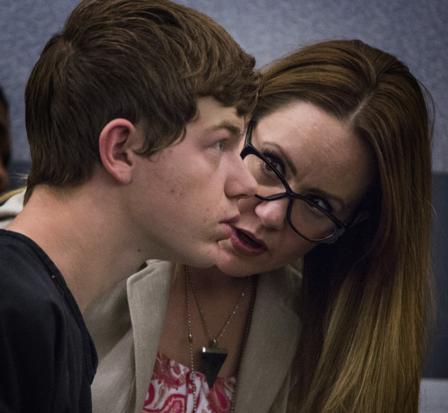 Public defender Amy Geliciano, right, confers with Turner Bronson during his initial appearance in Clark County Justice Court on Friday, May 30, 2014. Bronson is facing one murder charge in the sh ...