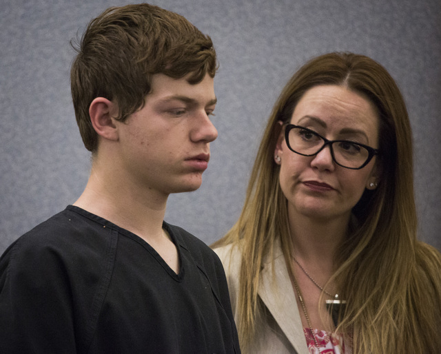 Turner Bronson, left, make his initial appearance in Clark County Justice Court on Friday, May 30, 2014. Public defender Amy Feliciano is beside him. Bronson, who will turn 16 on Sunday, is facing ...