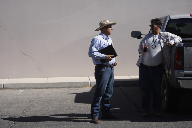 Ammon Bundy, left, son of rancher Cliven Bundy, talks with supporter John Lauricella before filing official complaints and pressing charges against federal law enforcement agents stemming from las ...