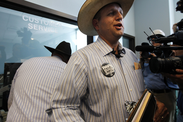 Ammon Bundy, son of rancher Cliven Bundy, talks with the media after filing official complaints and pressing charges against federal law enforcement agents stemming from last months failed cattle  ...