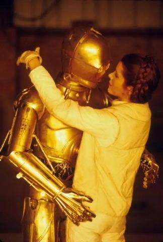 """""""C-3P0 and Princess Leia: Never, Ever Gonna Give You Up."""" (Courtesy photo via MentalFloss.com.)"""