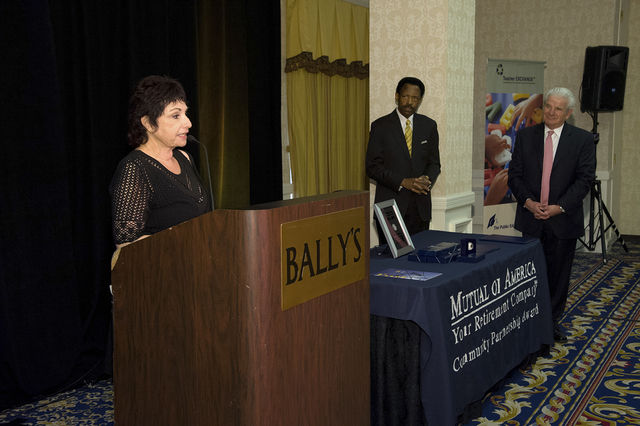 Judi Steele, President of The Public Education Foundation, accepts Mutual of America's Community Partnership Award during a ceremony April 9, 2014, at Bally's honoring the Foundation for its T ...