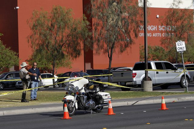 Metro Police investigate the scene where a pedestrian was hit by a car in front of Clark High School in Las Vegas on Wednesday, May 14, 2014. (Jason Bean/Las Vegas Review-Journal)