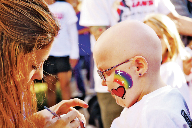 PM Digital photo via Nevada Childhood Cancer foundation Daniele Hague gets her face painted at the annual Danny Gans Memorial Champions Run for Life.