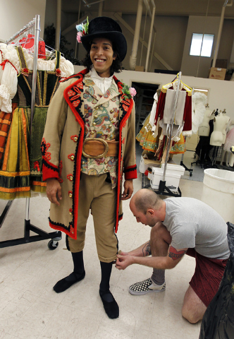 "Nevada Ballet Theatre dancer Barrington Lohr, standing, gets fitted by Costume Shop Manager Christopher Larson before rehearsal for the NBA's season closer ""Coppelia"" in their studio in  ..."