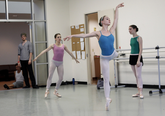 "Nevada Ballet Theatre dancers, including Hannah Schiller, middle in blue, rehearse for the NBA's season closer ""Coppelia"" in their studio in Summerlin on Thursday, April 24, 2014. (Jason ..."