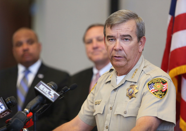 Clark County Sheriff Doug Gillespie, right, speaks during a news conference at the Lloyd D. George U.S. Courthouse Wednesday, May 21, 2014, in Las Vegas. Ronald Davis, director of the Office of Co ...