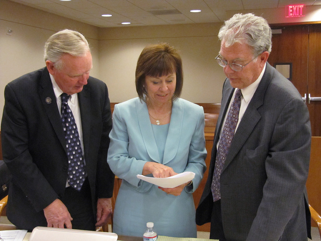 Sharron Angle, center, confers with Republican state Sen. Don Gustavson, left, and attorney Joel Hansen on Wednesday, May 7, 2014, in Carson City District Court following a hearing on challenges t ...