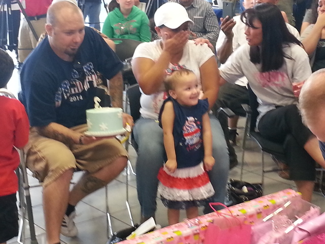 Retired U.S Army Sgt. Charles Copeland, Adriana Copeland and their 3-year-old daughter react to gifts from Findlay Chevrolet Saturday afternoon. Two unsuspecting veterans were surprised with 2014  ...