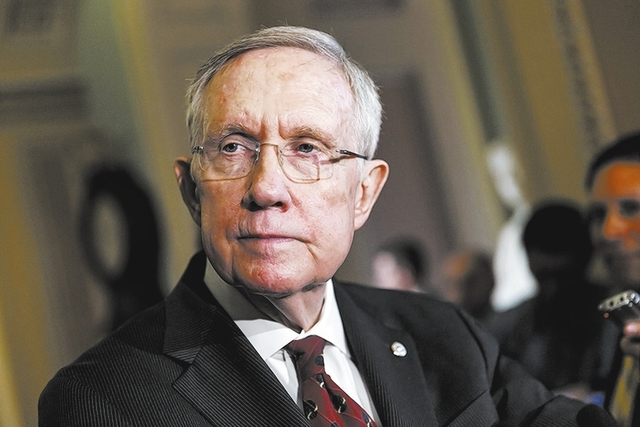 Senate Majority Leader Harry Reid, D-Nev., talks to reporters as Congress returns from a two week recess, at the Capitol in Washington, Tuesday, April 29, 2014. A long-shot Senate Democratic effor ...