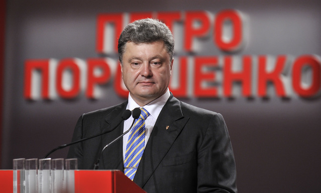 Ukrainian presidential candidate Petro Poroshenko during his press conference in Kiev, Ukraine, Sunday, May 25, 2014. An exit poll showed that billionaire candy-maker Petro Poroshenko won Ukraine' ...