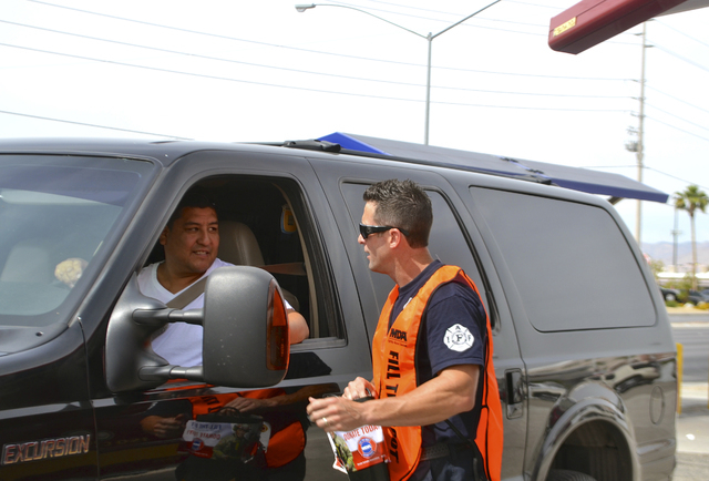 Las Vegas Fire & Rescue firefighter and community outreach chairman Todd Ingalsbee collects donations during the Fill the Boot Drive. Valley firefighters conducted the annual fundraising campaign  ...