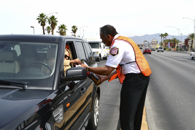 Las Vegas Fire & Rescue Chief William McDonald collects donations during the Fill the Boot Drive. Valley firefighters conducted the annual fundraising campaign in May. Funds will help support the  ...