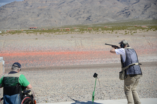 Kenny Roger, left, and Dave Zurfluh participate in a trap shooting event hosted by the Nevada chapter of the Paralyzed Veterans of America. (Special to View)