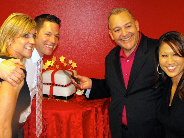 Denny Seybert, left, and Jaime Velez celebrate the grand opening of their new Keller Williams Reality of Southern Nevada office in Henderson. (Special to View)