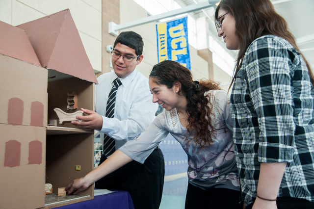 From left, Sunrise Mountain High School AP Spanish students Ulises Delgado, Vanessa Pacheco and Kimberly Verdin organize details of their model, depicts the Cortijo Jurado, a 19th century mansion  ...