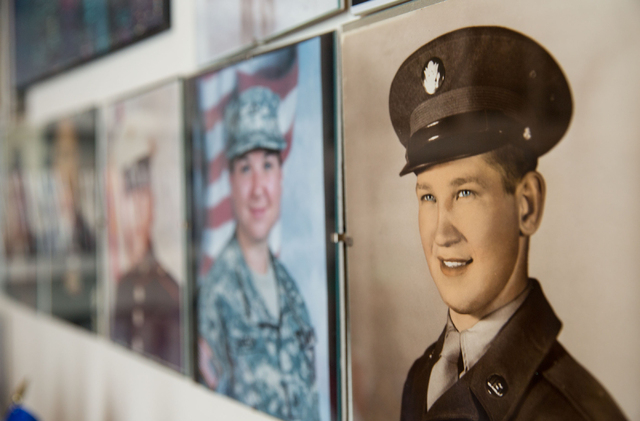Bernard Hebert, right, at the age of 19, is one of 27 portraits of friends and family hanging on Phyllis Hebert's wall in her Las Vegas home Friday, May 23, 2014. After Bernard Hebert's death in 2 ...