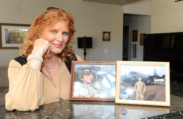 Kathleen Keutmann poses with photos of her sons at her home in Henderson, Monday, April 28, 2014. Jon, left, is serving at Ft. Campbell, Kentucky, and Patrick is serving in Okinawa. (Jerry Henkel/ ...