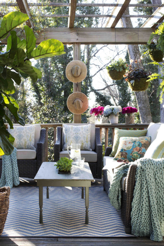 In this photo provided by Brian Patrick Flynn/HGTV.com, thanks to a pergola overhead, the outdoor lounge of the HGTV.com Spring House designed by Flynn remains cool and shaded from the harsh sprin ...