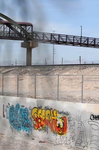 Graffiti is seen sprayed on a wall near the newly completed pedestrian bridge over Losee Road and Interstate 15 between Cheyenne Avenue and Craig Road in North Las Vegas on Saturday, May 17, 2014. ...