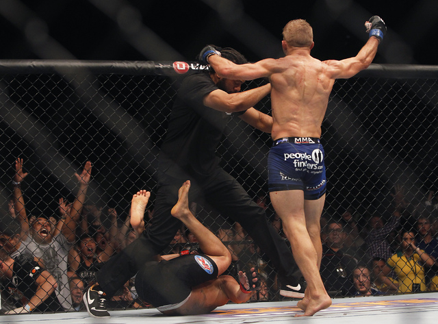 TJ Dillashaw celebrates after defeating Renan Barao during UFC 173 at the MGM Grand Garden Arena in Las Vegas on Saturday, May 24, 2014. (Jason Bean/Las Vegas Review-Journal)