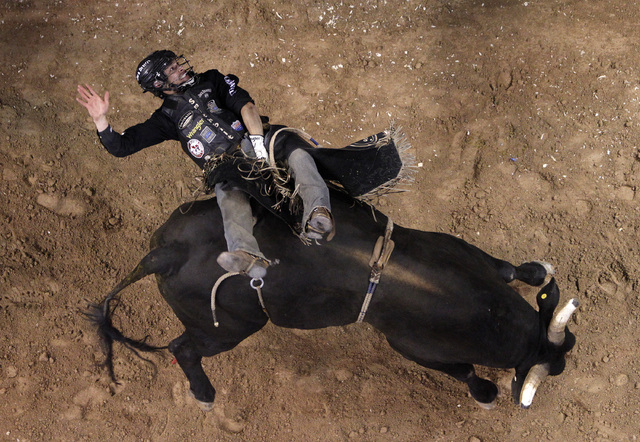 Ty Pozzobon gets bucked off of Ranga during the final night of the PBR Las Cowboy Standing at Mandalay Bay in Las Vegas Saturday, May 10, 2014. (John Locher/Las Vegas Review-Journal)