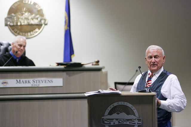 Dr. Jack Schofield, 89, speaks in Judge Mark Stevens' courtroom at Henderson Municipal Court in April 2013 in Henderson. Schofield spoke to a group of Veterans Court graduates about his life in La ...