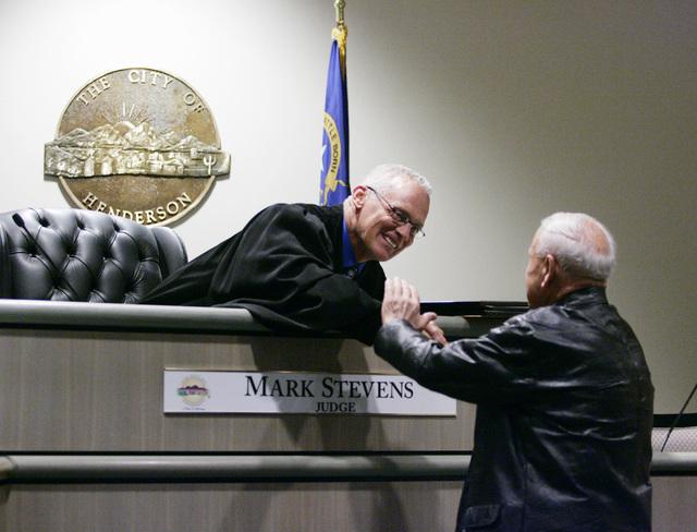 Judge Mark Stevens, left, and Dr. Jack Schofield, 89, shake hands in Stevens' courtroom at Henderson Municipal Court in April 2013 in Henderson. Schofield spoke to a group of Veterans Court gradua ...