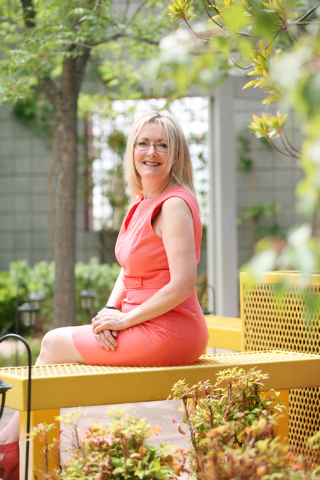 Florence Rogers, president and CEO of KNPR Nevada Public Radio, sits in a courtyard at Donald W. Reynolds Broadcast Center Friday, May 16, 2014, in Las Vegas. Rogers fed seals and sold tickets whi ...