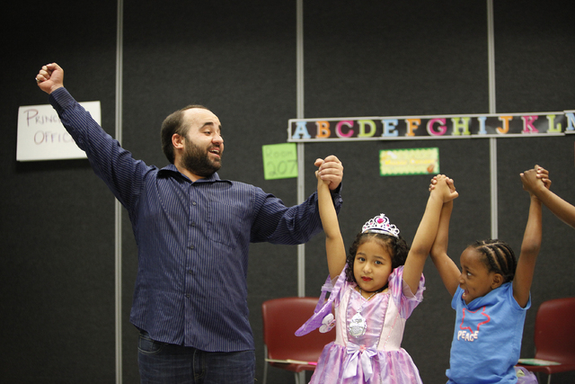 John Tomasello, left, teaches a storybook theater class with Sahely Santillan, center, and Karinna Zemp at the Black Mountain Recreation Center in Henderson, Nev. Saturday, April 19, 2014. (John L ...
