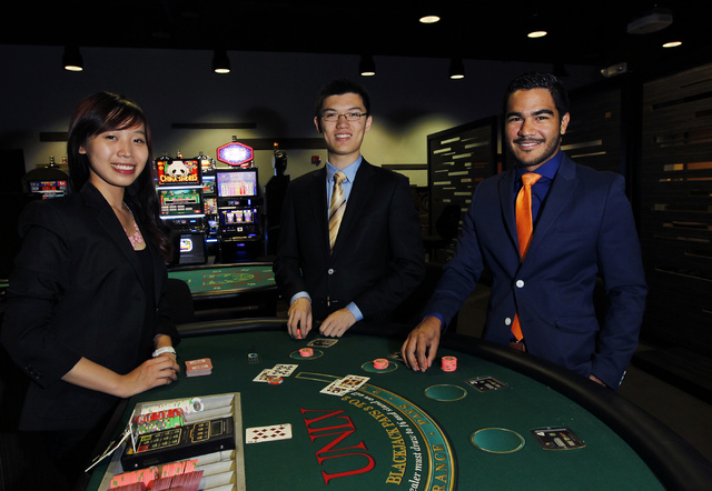 UNLV Gaming Innovation students, from left, Hien Nguyen, He Lin, and Aron Kock pose for a portrait in the Konami Gaming Lab in the Stan Fulton Building on the UNLV campus in Las Vegas on Friday, M ...