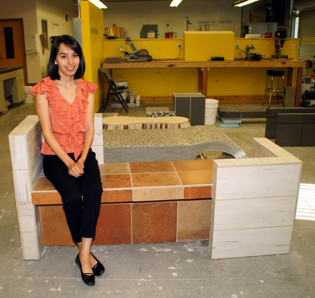 Photo by Art Nadler Brenda Tena, a second-year interior architecture design student, sits on her completed desert plateau themed bench.