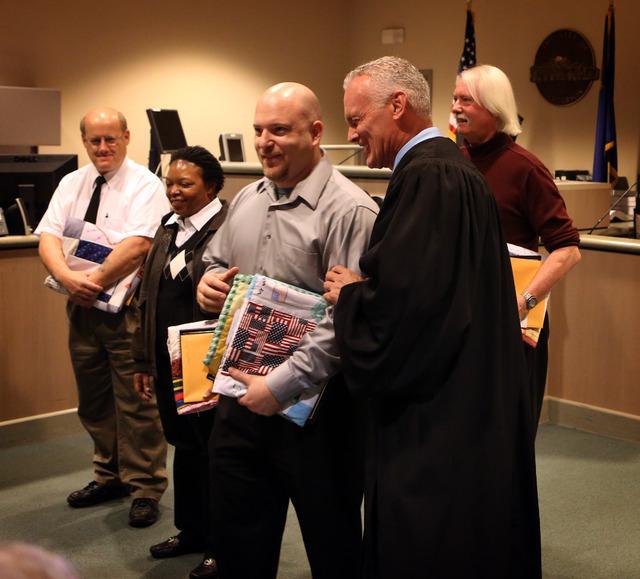 Judge Mark Stevens embraces Jason Brooks after he graduated from Veterans Court at the Henderson Municipal Court in December 2012. Other graduates, from left, were Jeffrey Johnson, Jacqueline Henr ...