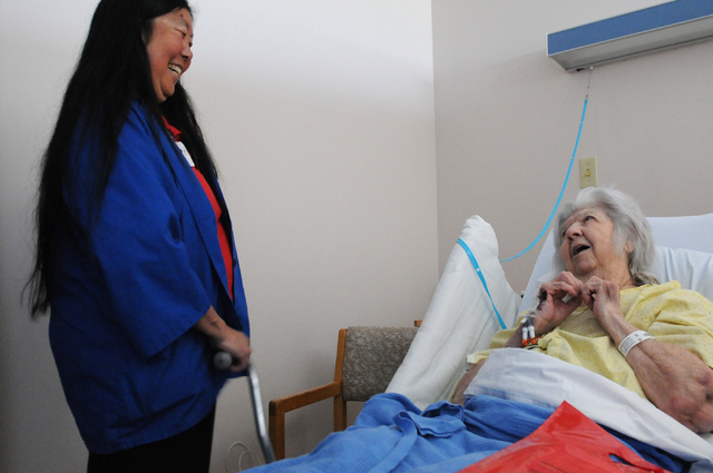 Volunteer Lori Wright, left, speaks with stroke patient Mary Parlette at Valley Hospital Medical Center in Las Vegas Wednesday, April 23, 2014. Wright roams patient's rooms to share information ab ...