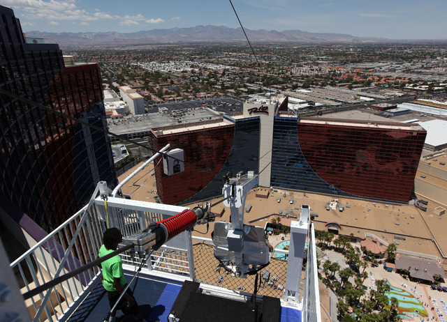 A rider launches from the platform of the VooDoo Zipline from the 50th floor of the Rio in Las Vegas on Sunday, May 25, 2014. The ride is 490-feet above the ground and zips down the line at 33 mil ...
