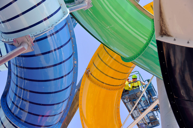 Anthony Murillo with Evans Recreation Installers works to secure one of the water slides at Cowabunga Bay water park in Henderson on Monday, May 12, 2014. The $25 million project is scheduled to o ...
