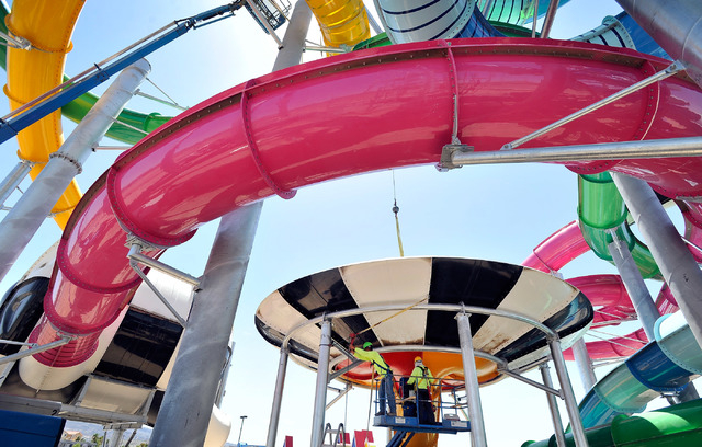 Justin Ebel with Evans Recreation Installers cranks a come-along to secure one of the water features at Cowabunga Bay water park in Henderson on Monday, May 12, 2014. The $25 million project is sc ...