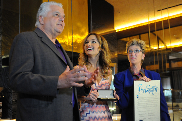 Clark County Commissioners Chris Giunchigliani, right, and Steve Sisolak, left, present a proclamation to celebrity chef Giada De Laurentiis for her restaurant opening at The Cromwell during the h ...