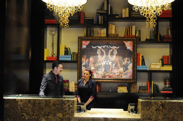 Gia Rampolla, right, and Nick Ippolito, concierge at The Cromwell, wait for guests during the hotel's grand opening Wednesday, May 21, 2014. (Erik Verduzco/Las Vegas Review-Journal)