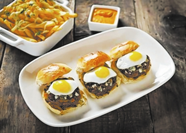 Angus Mini Burgers at Crush Eat, Drink, Love, MGM Grand: A trio of diminutive burgers are topped with buttermilk blue cheese, balsamic onions and fried quail eggs. (Courtesy)