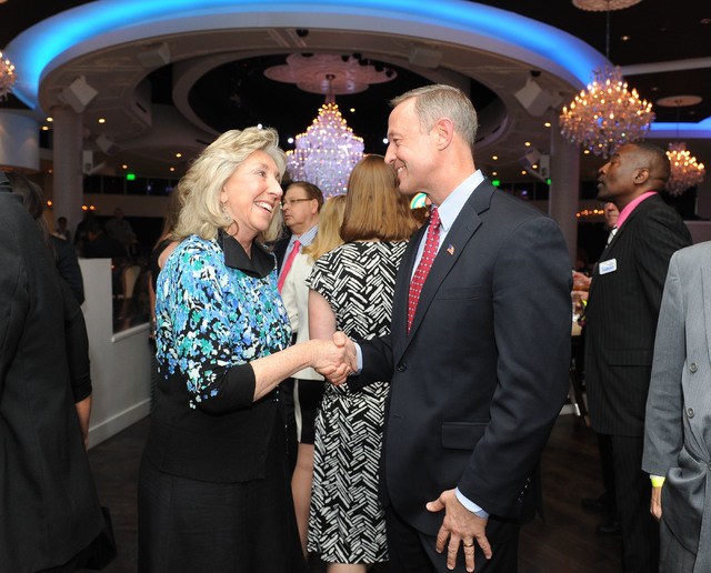 Congresswoman Dina Titus shakes hands with Maryland Gov. Martin O'Malley at the Nevada Democratic Party's Jefferson-Jackson dinner at the Tropicana hotel-casino in Las Vegas, Friday, May 2, 2014.  ...